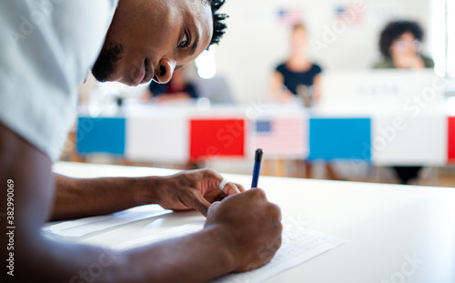 Fototapeta African-american man voter in polling place, usa elections concept. obraz