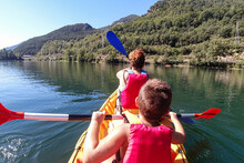 Mother And Son On A Kayak. Bac...