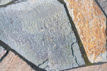 Floor Of Different Stones. The Tile Is Not The Correct Shape. Stone Background