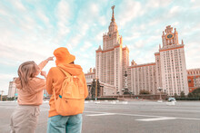 Female Friends Travel To Touri...