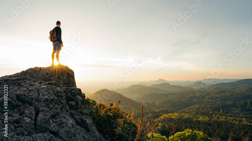 Fotografie, Obraz Hiker, Backpacking on top of a mountain cliff