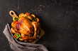 Fall thanksgiving table with roasting chicken or turkey food on black background