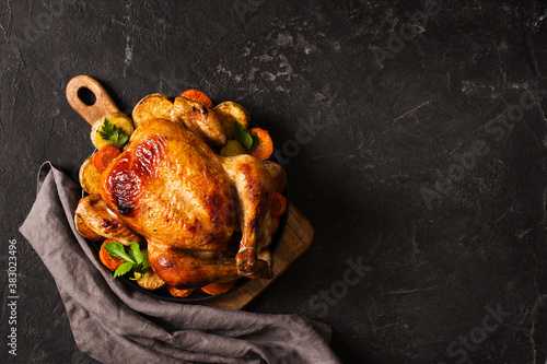 Canvas Print Fall thanksgiving table with roasting chicken or turkey food on black background