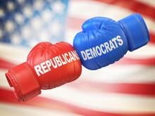 Democrats Vs. Republicans. Two Boxing Gloves Against Each Other In Colors Of Democratic And Republican Partie, 3d Rendering