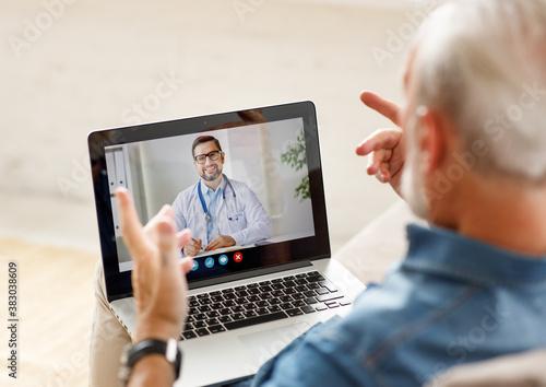 Fototapeta Senior man speaking with online doctor. obraz na płótnie