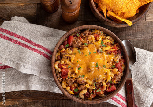 Photo Bowl of chili mac with cheddar cheese
