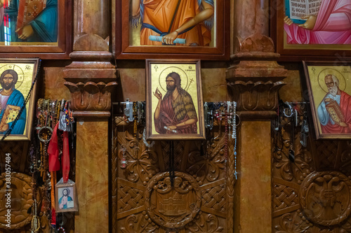 Numerous donations from believers hang near the icon in the Church of the Apostl Canvas Print