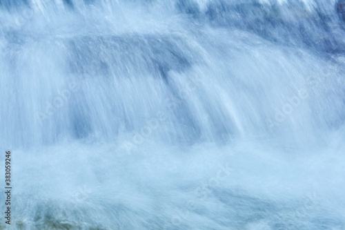Tablou Canvas natural background - the jets of the waterfall are blurred in motion