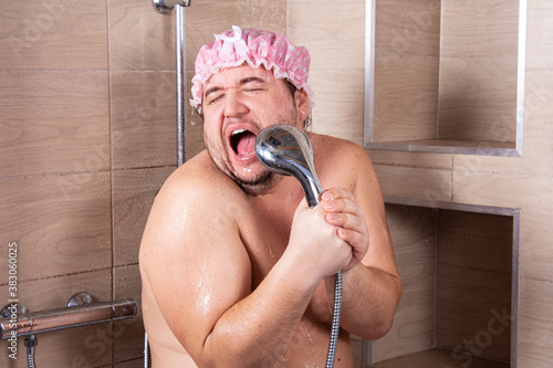 Funny fat man in the shower.