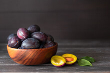 Ripe Blue Plums In A Bowl On T...