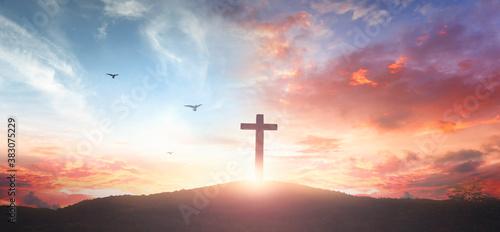 Vászonkép Christian wooden cross on the mountain  sunset background