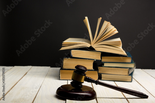 Canvas Print Law concept - Open law book with a wooden judges gavel on table in a courtroom or law enforcement office isolated on white background