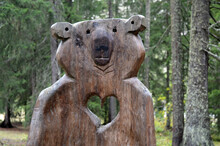 Bear Wooden Statue In The Forest
