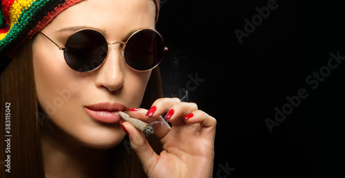 Attractive hippie young woman smoking marijuana