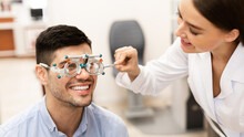 Optometrist Checking Patients ...