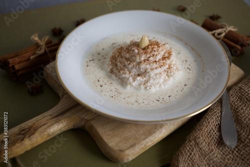 Fototapeta Scandinavian Christmas porridge with almond on top. obraz