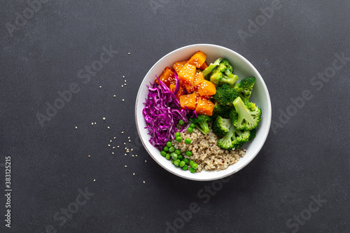Leinwand Poster Vegetarian quinoa and broccoli lunch Buddha bowl with baked butternut squash or