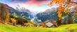 Scenic autumn view of picturesque alpine Wengen village and Lauterbrunnen Valley