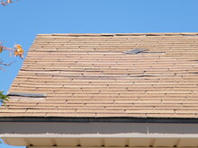 Roof Shingle Damage From Wind.