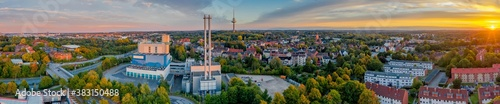 Obraz Panorama aerial view of district Hassee-Vieburg and television tower of Kiel, Schleswig-Holstein, Germany. Panoramic aerial view of incineration plant in the city.  - fototapety do salonu