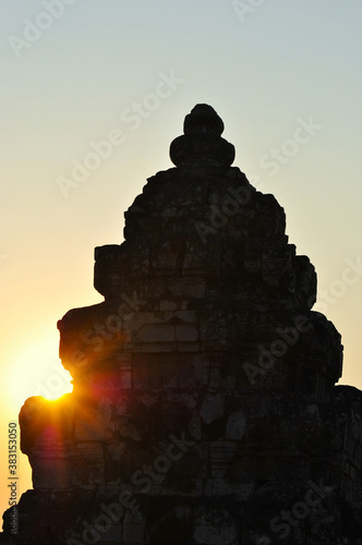 Evening sun and the old tower of Phnom Bakheng temple in Angkor Wall mural
