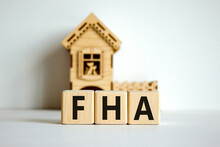 Wooden Cubes Form The Word 'FH...