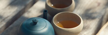 Chinese Tea Ceremony. Ceramic Teapot Made Of Clay And Bowls On A Wooden Background.