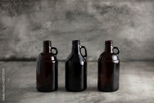 Fotografie, Obraz beer growler bottles for craft beer with white space for a copy over a grey back