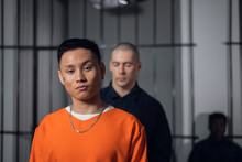 An Asian Prisoner Leaves His Cell In The Prison For Transfer To Another Place Of Detention, Accompanied By An Armed Guard