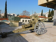 An Old, 1925, French, Schneider 85mm Field Gun, And A British, Cromwell Tank Turret, In Athens, Greece