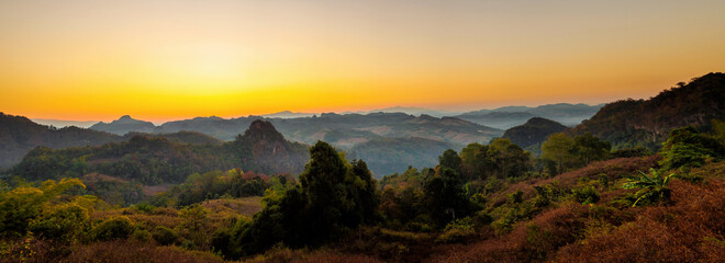 Panoramic view of beautiful sunrise over mountain landscape in Mae Hong Son , Thailand.