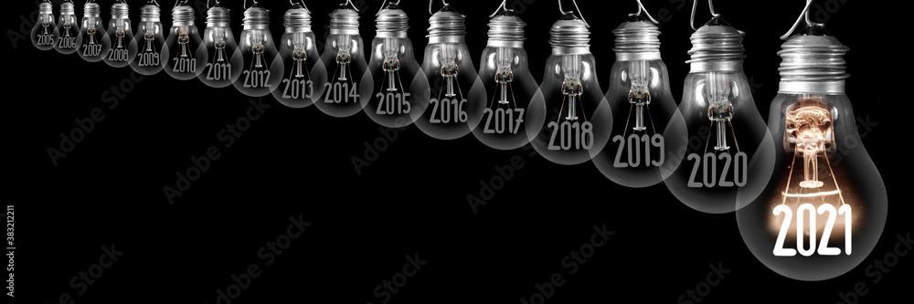 Fototapeta Light Bulbs with New Year 2021