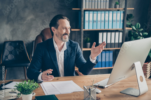 Portrait of his he nice attractive cheerful cheery glad friendly man head lawyer specialist expert meeting staff company online discussing plan at modern concrete industrial workplace station