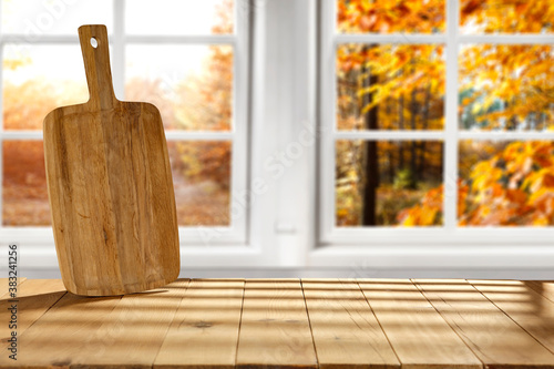 Desk of free space and autumn window