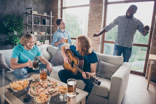 Obraz na plátně Four buddies have fun house indoors sit cozy couch blonde hair man pop star play
