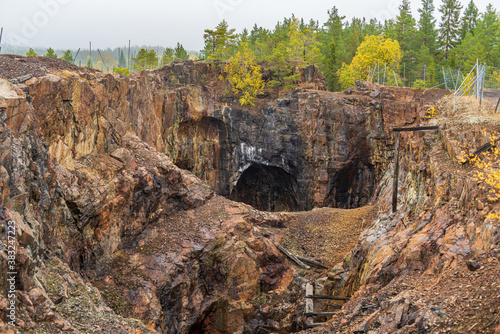 Cuadros en Lienzo Old closed down open-pit mine in Sweden, with steep edges and shafts