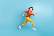 Full Size Profile Photo Of Attractive Funny Lady Rushing Shopping Center Sale Discount Runaway Want Come First Early Morning Wear Orange Shirt Trousers Sneakers Isolated Blue Color Background
