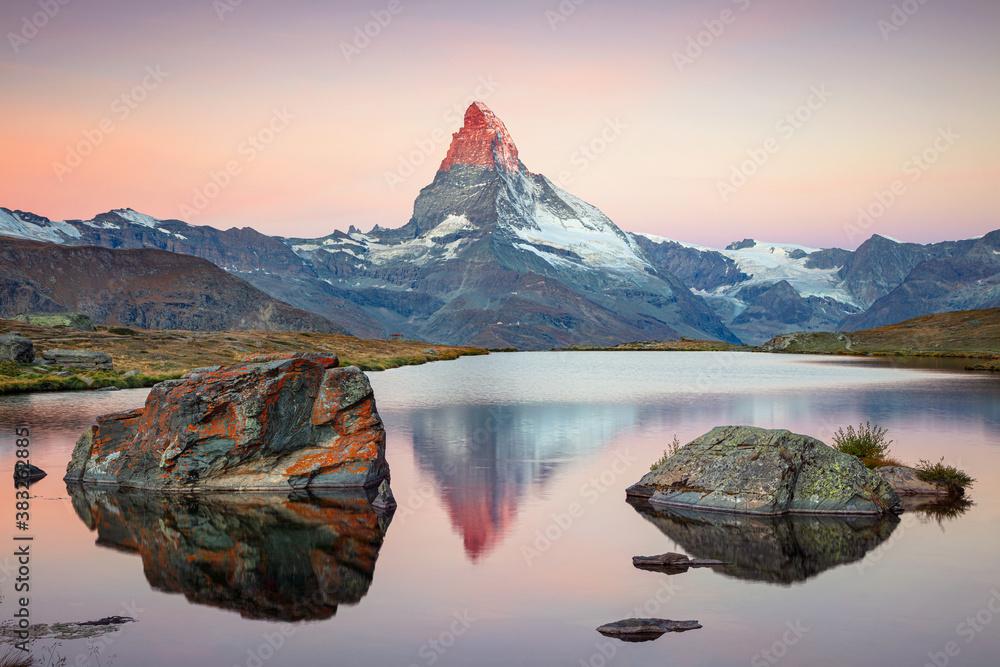 Fototapeta Matterhorn, Swiss Alps. Landscape image of Swiss Alps with Stellisee and Matterhorn in the background during sunrise.