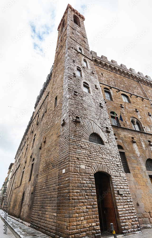 travel to Italy - wet tower of Bargello palace (Palazzo del Bargello, Palazzo del Popolo, Palace of the People) in Florence city after rain