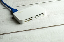 Memory Card Reader On Wooden White Background