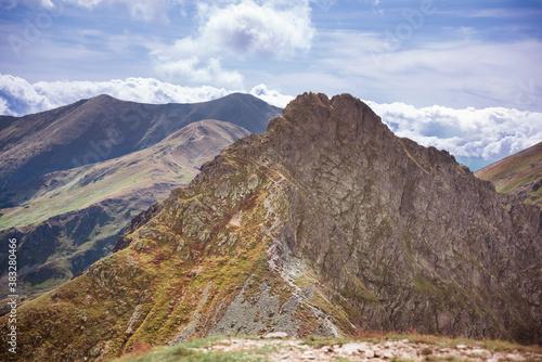Fototapeta Dangerous mountains - steep and narrow path on a ridge to rocky summit of Rohacz Ostry obraz