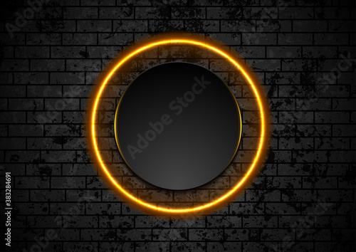 Orange neon circle on grunge brick wall background. Vector retro design
