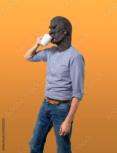 Man in Gorilla Mask Drinking from Mug Profile View фототапет