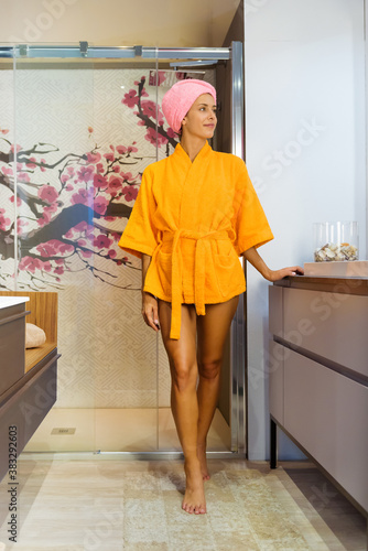 Canvastavla Young woman exiting a glass shower cubicle