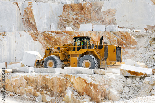Heavy duty front end loader transporting marble