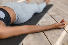 Unrecognizable African Woman Lying On Yoga Mat In Corpse Pose, Cropped Image
