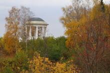A White Wooden Rotunda In Autumn Park.