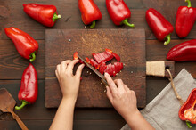 Woman Cuts Red Bell Pepper Int...