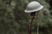 World War Era Brodie Helmet And Rifle