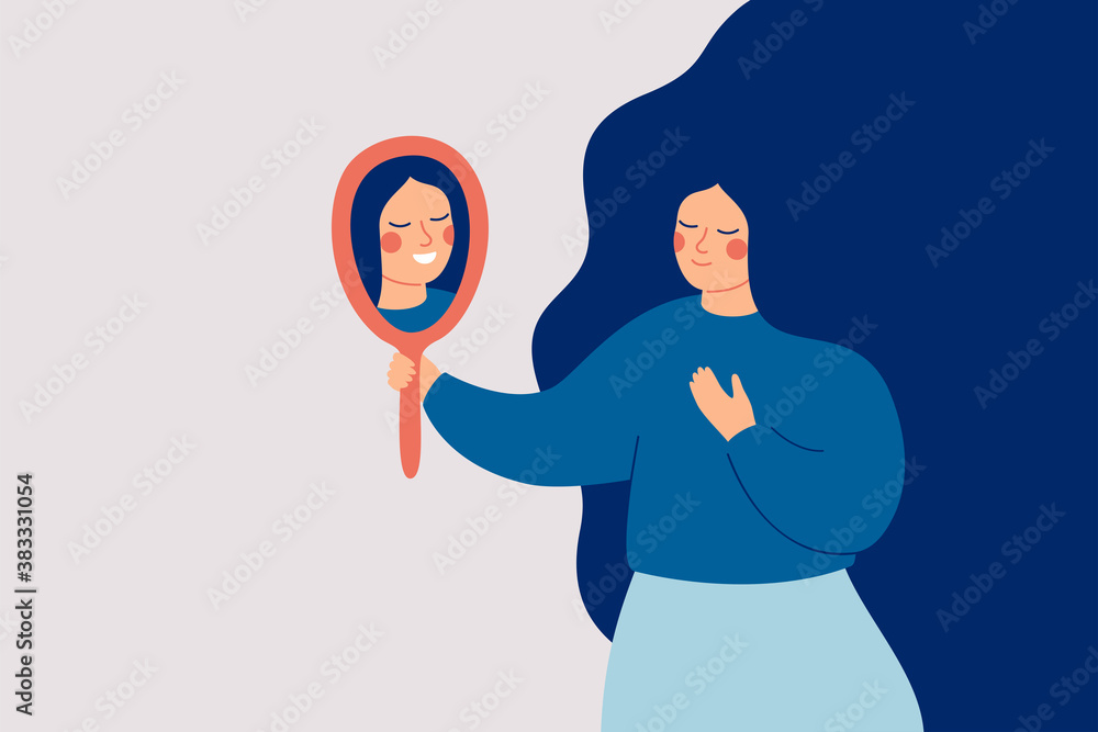 Fototapeta Young woman looks at the mirror and sees her happy reflection. Self-acceptance and confidence concept.